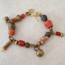 Brass Bracelet with Old Beads and Charms