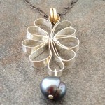 Sterling Silver Pendant Necklace with  a Blossoming Medallion and a Pearl