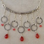 Sterling Silver Necklace with Rings and Fire Cubic Zirconia Briolettes